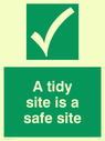Safe condition safety sign with safe condition tick in white on a green background. Text: A tidy site is a safe site