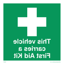 inside fixing window sticker - first aid symbol Text: this vehicle carries a first aid kit