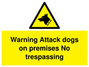 guard dog in warning triangle Text: Warning Attack dogs on premises No trespassing