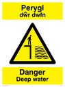 bi-lingual welsh / english sign with man on quay side in warning triangle Text: perygl dwr dwfn danger deep water