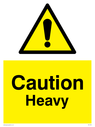 <p>exclamation in warning triangle</p> Text: Caution heavy