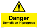 exclamation in warning triangle Text: danger demolition in progress