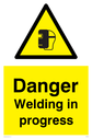 welding mask symbol in warning triangle Text: Danger Welding in progress