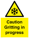 <p>Caution Gritting in progress</p> Text: