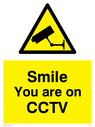 cctv-sign-with-yellow-background-black-text-and-cctv-symbol~