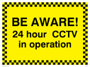 Security sign - 24 hour CCTV in operation Text: Be Aware 24 hour CCTV in operation