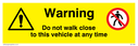 Warning, Do not walk close to this vehicle at any time with general warning and no access symbols Text: Warning, Do not walk close to this vehicle at any time
