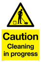 cleaning warning symbol in warning triangle Text: Caution Cleaning in progress
