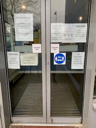 Example image of 2m distance sticker applied to external glass door