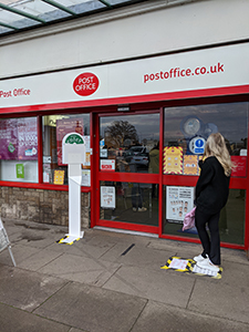 Freestanding QControl managing the queue outside a post office counter